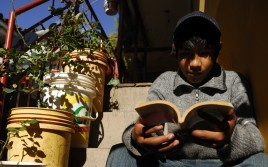 PERU_boy_reading_on_steps