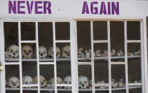 Never_Again_-_With_Display_of_Skulls_of_Victims_-_Courtyard_of_Genocide_Memorial_Church_-_Karongi-Kibuye_-_Western_Rwanda_-_02  cropped