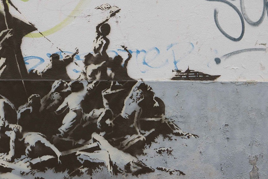 Banksy: We're not all in the same boat.  Calais.